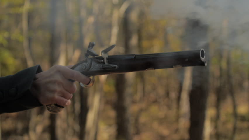 VIRGINIA - OCTOBER 2016 - Reenactment, Founding Fathers, Patriots, American Revolutionary War era recreation -- 18th - 19th Cent. Flintlock dueling pistol fires in woods during duel. Hamilton/Burr.