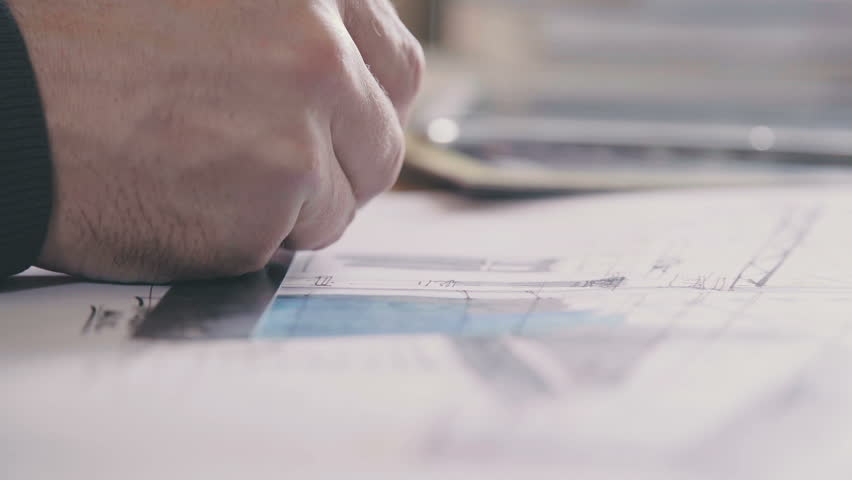 Male architect at work. Architect Hands. Ruler and a pencil in the hand of the architect. Design of the house. Engineer. Tools for drawing. Creating a drawing. Architecture. | Shutterstock HD Video #25053314