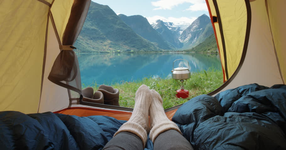 Camping woman lying in tent Close up of Girl feet wearing hiking boots relaxing on vacation POV | Shutterstock HD Video #25065488