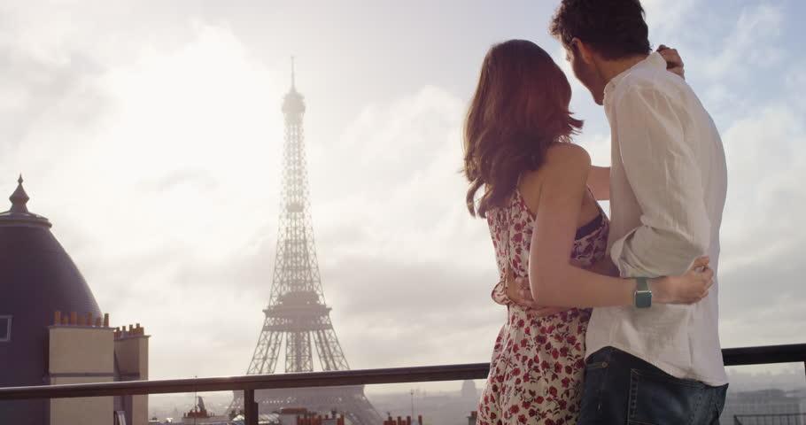 Romantic couple in Paris Eiffel Tower embrace kissing honeymoon enjoying European summer holiday travel vacation adventure   Shutterstock HD Video #25124384