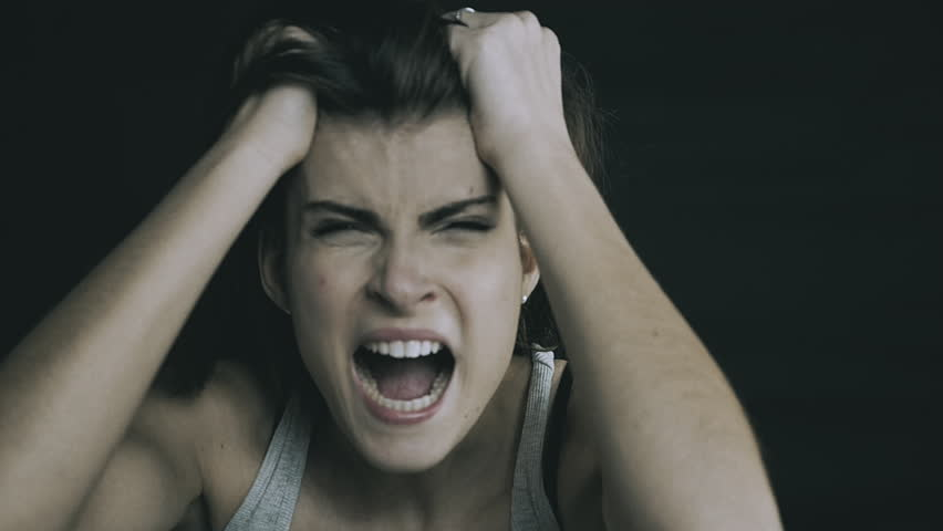 Woman crying and screaming after domestic violence concept