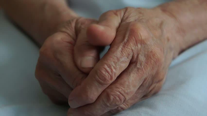 Senior woman with wrinkled hands.