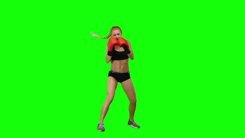 Boxer standing in the front and sends butted an opponent standing on the spot. Green screen   Shutterstock HD Video #25547219