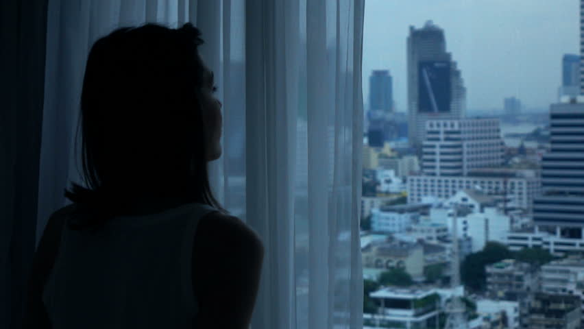 Young woman admire view from window at home, super slow motion 240fps  | Shutterstock HD Video #25608434