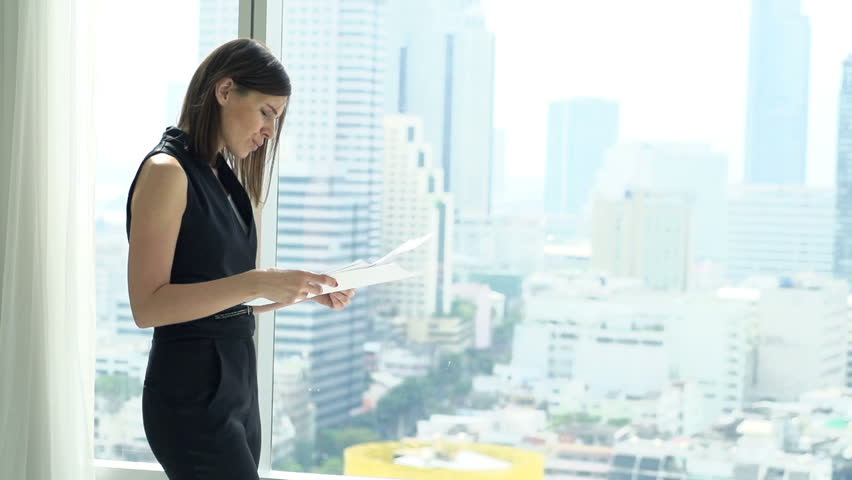 Sad, unhappy businesswoman working with documents by window, super slow motion 240fps  | Shutterstock HD Video #25608785