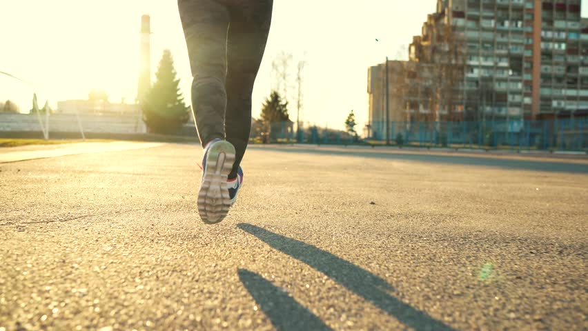 Running shoes - woman tying shoe laces and running outdoors | Shutterstock HD Video #25618682