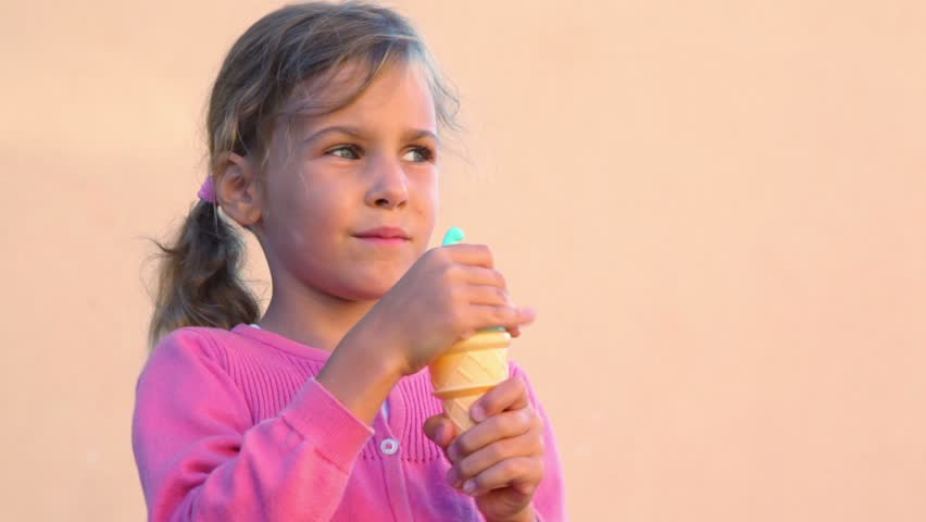 Little Girl Stands With Bottle In Form Of Ice Cream Then
