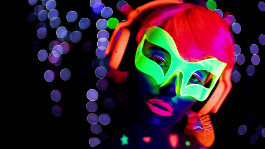 4k fantastic video of sexy cyber raver woman filmed in fluorescent clothing under UV black light | Shutterstock HD Video #25897340