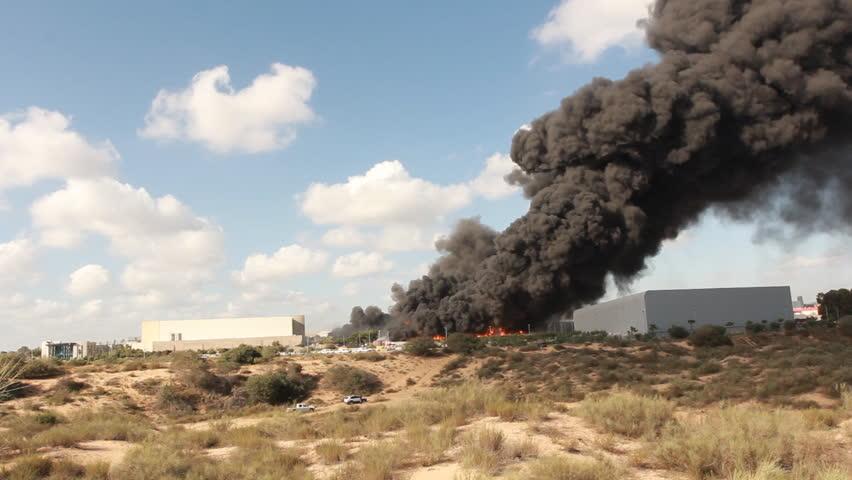 Firefighters battle blaze in packaging industrial factory fire