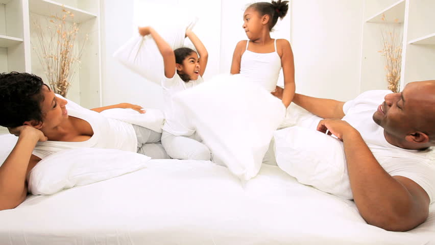 African American Children Playing In Parents Home Bed -9159