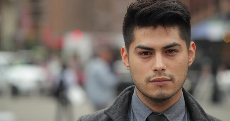 Young Hispanic Latino man in city face portrait #26109116