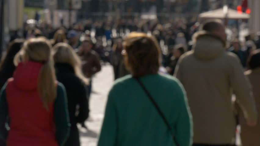 Blurred unrecognizable people walk along sunny spring street slow motion video | Shutterstock HD Video #26142752