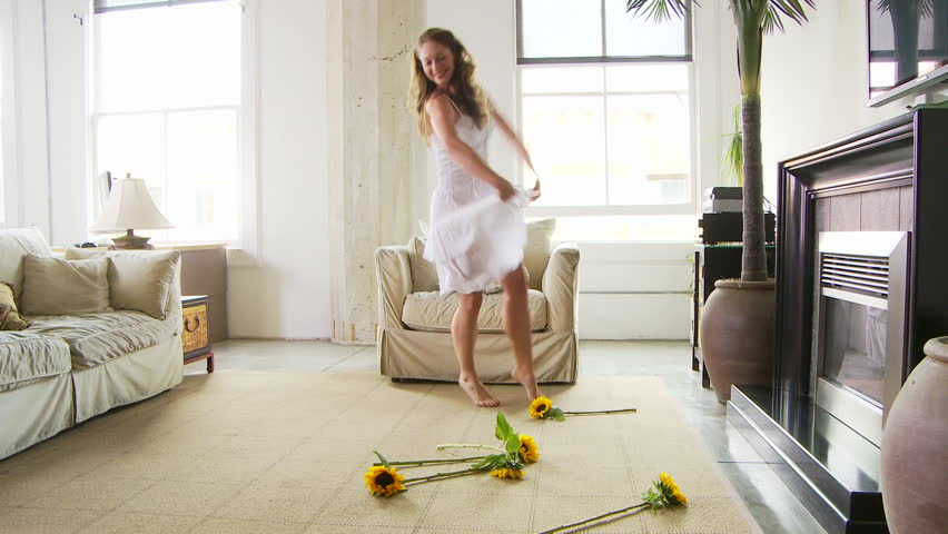 woman dancing with sunflowers   HD stock footage clip. Carefree Young Caucasian Woman Dancing In Her Bedroom Stock