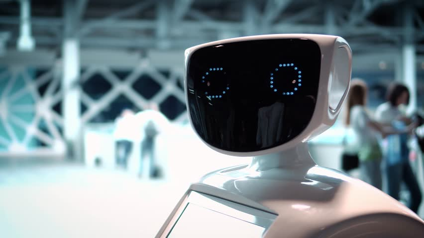 Modern Robotic Technologies. The robot looks at the camera at the person. The robot shows emotions. Raises his hands up, dances or is indignant. Or attacks