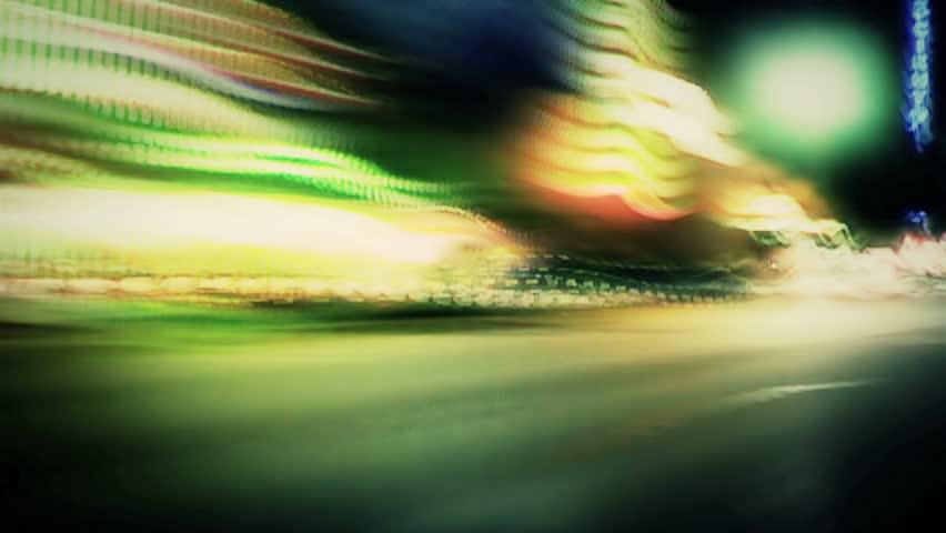 HD - Night lights streak as we travel down a city street (Loop).  Formats available: HD-NTSC-PAL | Shutterstock HD Video #2631776