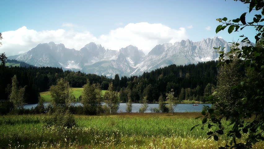 Mountain And Lake Panoramic View stock footage. The Austrian Alps in the