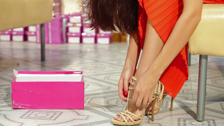 Young Woman Trying On High Heels In Shoe Store Stock Footage Video