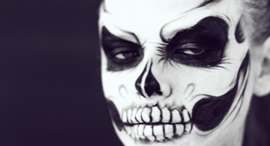 Girl with creative halloween face art on black background. | Shutterstock HD Video #26735956