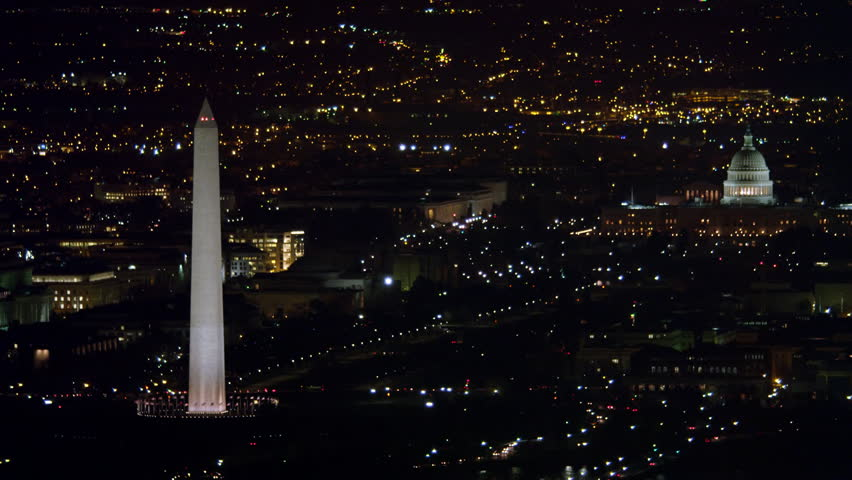 Over Washington DC cityscape at night, Washington Monument and Capitol in distance. Shot in 2011.