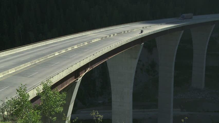 Truck traffic on a high bridge