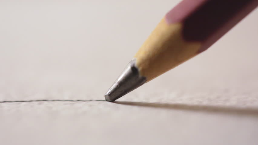 Artists hands drawing wooden pencil writes line on paper.