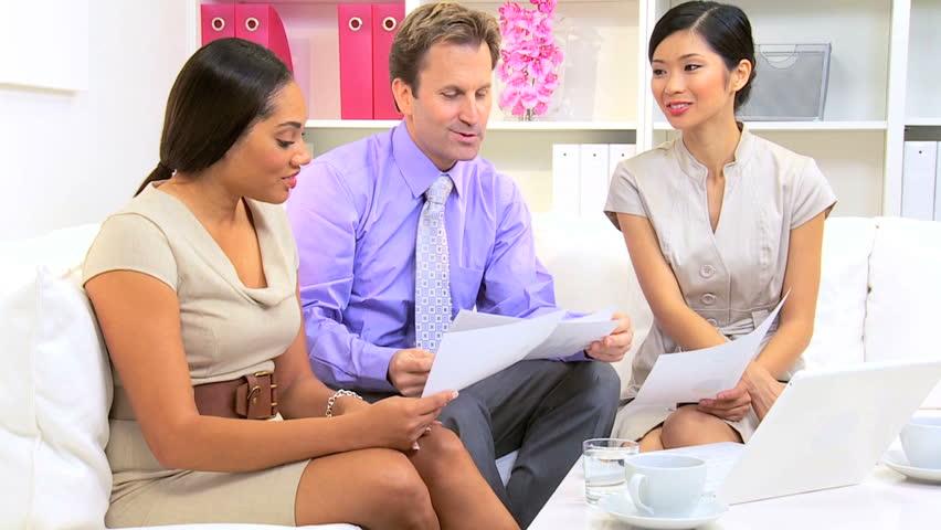 Caucasian Male Advertising Executive Informal Meeting Of Multi ...