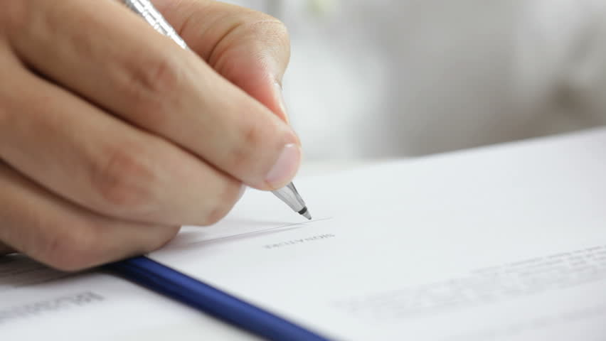 Businessman signing a contract. Signature is fake   Shutterstock Video #2703713