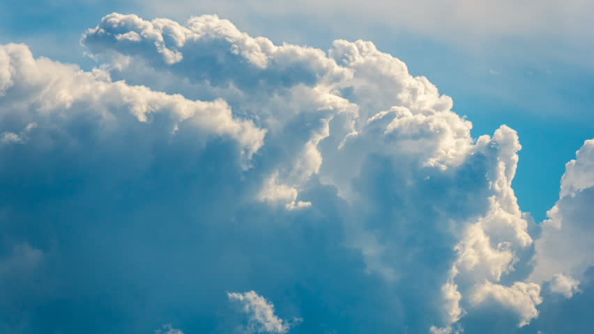 Time lapse motion video footage in 4096x2304 4K resolution of white puffy, fluffy, cumulus clouds rolling, flying, passing, fast moving blue sky at cloudy summer day, good as nature background | Shutterstock Video #27255769