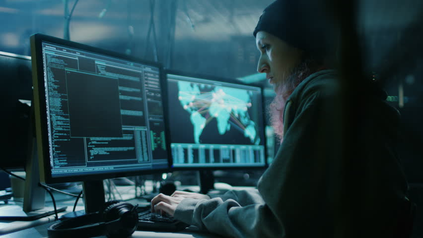 Nonconformist Teenage Hacker Girl Organizes Malware Attack on Global Scale. They're in Underground Secret Location Surrounded by Displays and Cables. Shot on RED EPIC-W 8K Helium Cinema Camera. | Shutterstock HD Video #27315505