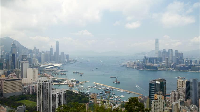 Hong Kong Harbor panorama cityscape - Central District, Victoria Harbor, Victoria Peak, Hong Kong Island and Kowloon, Hong Kong. | Shutterstock HD Video #2744717