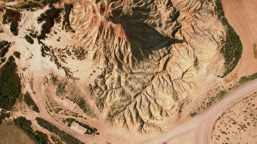 Top view drone footage flying over high peak in national reserve park dry and beige desert, erosian made geological mountain pillar, drought resulted landscape, global warming threat | Shutterstock HD Video #27682762