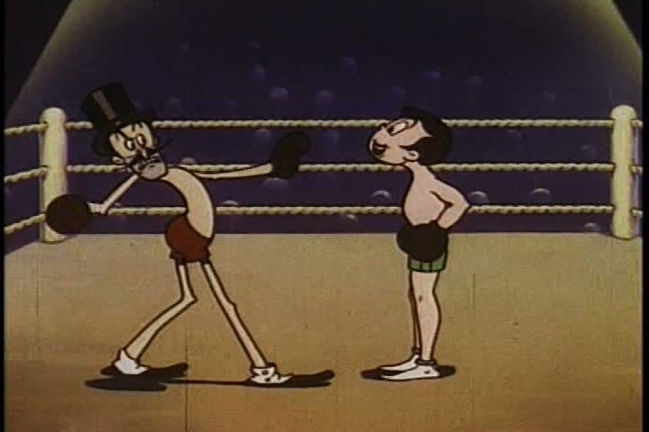 1930s: A villainous boxer is knocked out by a heroic opponent, in a boxing ring, animated, as rules for driving are announced, in 1936.