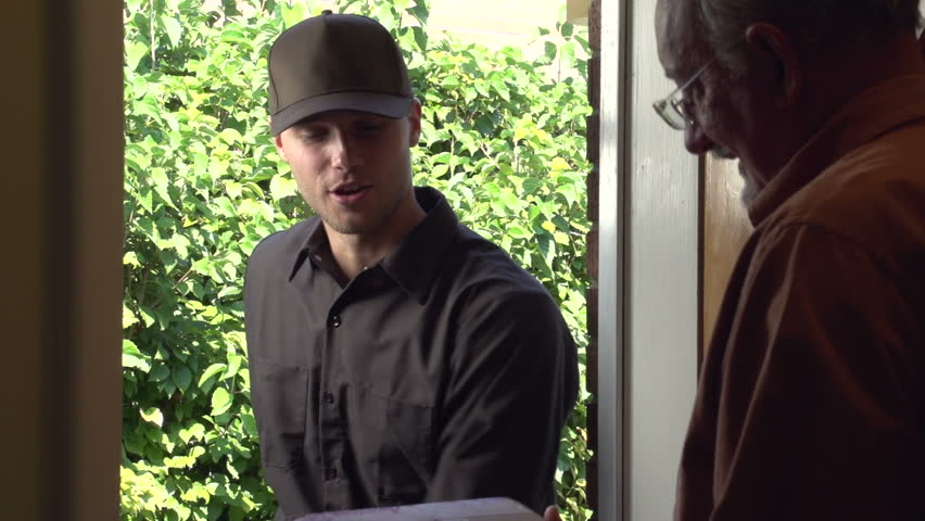 Delivery man delivering package to a home