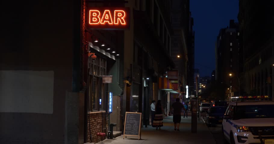 A nighttime exterior establishing shot of a generic, unbranded bar and restaurant in downtown Manhattan, New York City. Day/Night matching available. | Shutterstock HD Video #27851221