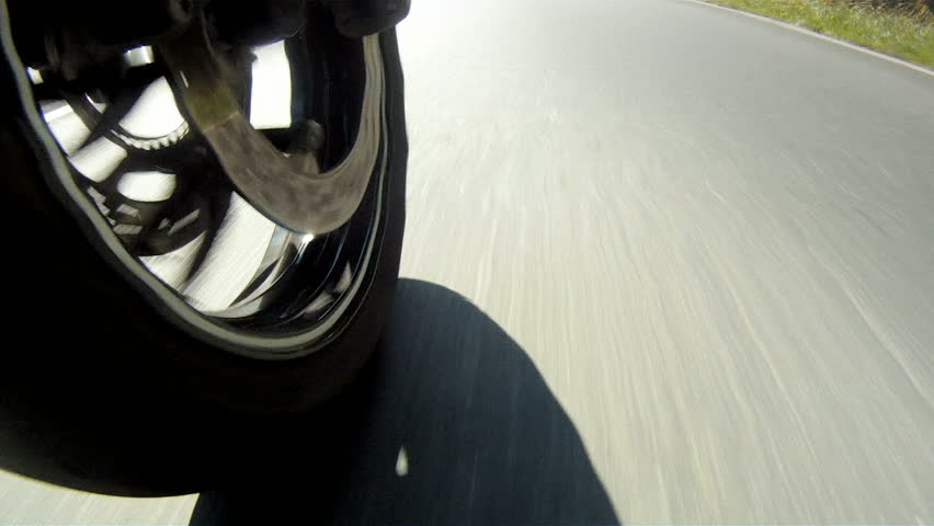 Motorcycle Wheel Close-up racing on the highway