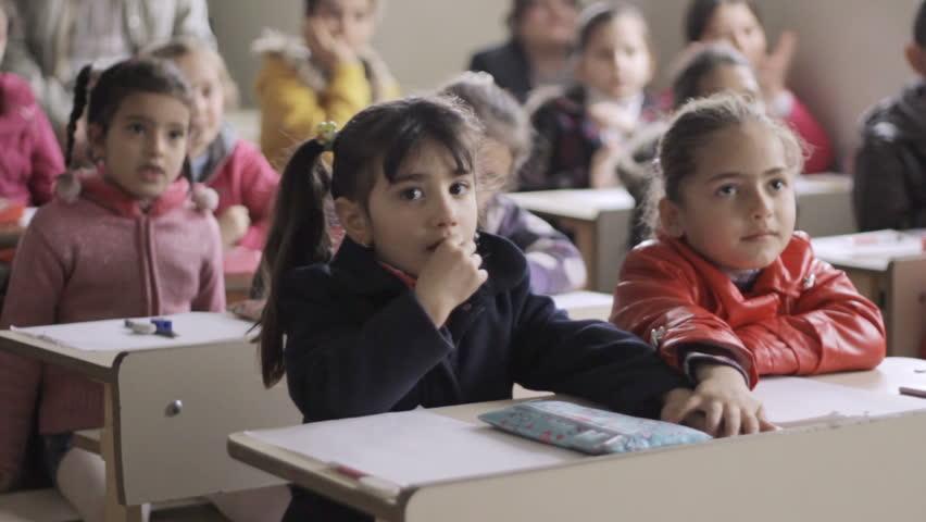 ERBIL, IRAQI KURDISTAN - CIRCA JANUARY 2016: Showing life of IDPs families into the Christian IDP's Ashti camp in Ankawa district, Erbil. One normal day in primary school. | Shutterstock HD Video #28010302