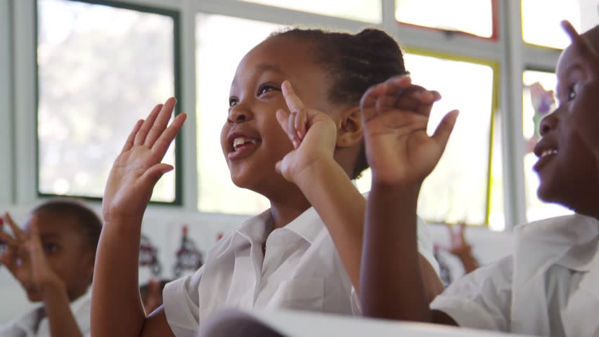 School kids counting with fingers at an elementary school   Shutterstock HD Video #28049509