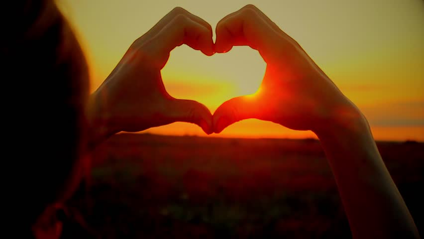 Hands forming a heart shape with sunset silhouette | Shutterstock HD Video #28288411
