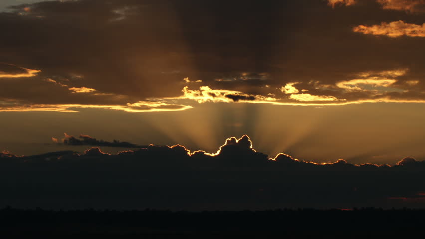 Spectacular sunrises over ominous thunderstorm on the horizon. HD 1080p time