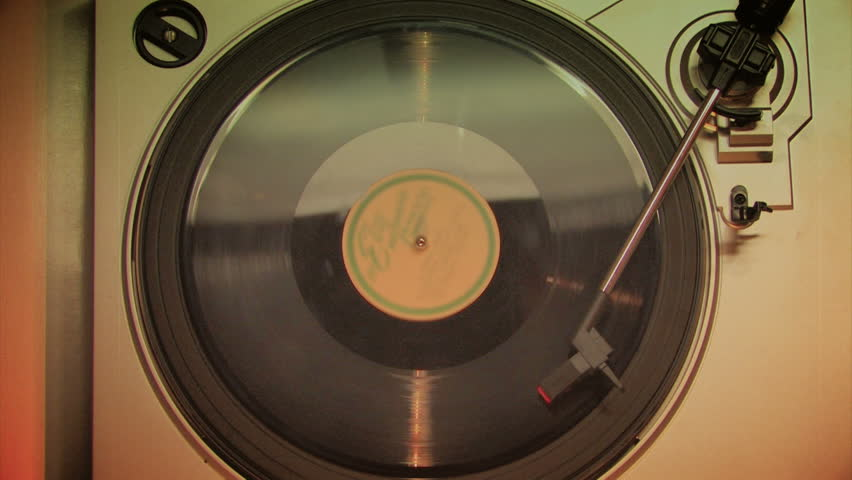 A retro-styled film look of a spinning record player. | Shutterstock HD Video #2832232