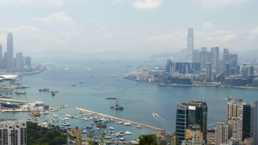 Hong Kong Harbor panorama cityscape - Central District, Victoria Harbor, Victoria Peak, Hong Kong Island and Kowloon, Hong Kong. | Shutterstock HD Video #2853625