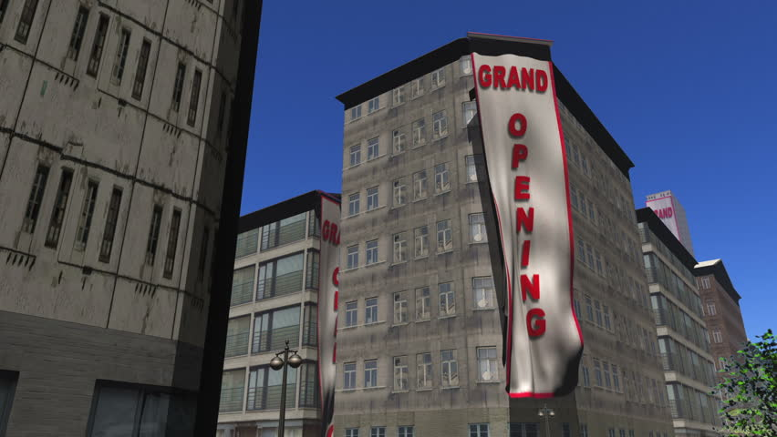 Grand Opening banners unfurl down 3 buildings