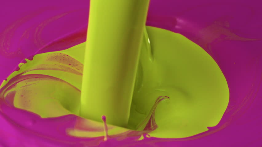 Pouring yellow paint into pink paint shooting with high speed camera, phantom flex.