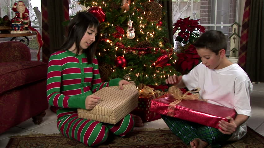 Father And Little Boy In Pajamas Opening Christmas Present Stock ...