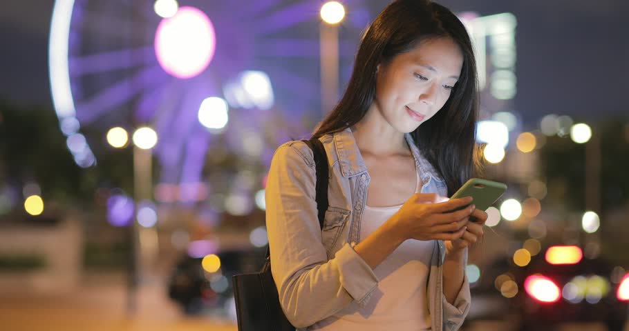 Woman working on smart phone in the city | Shutterstock HD Video #28725010
