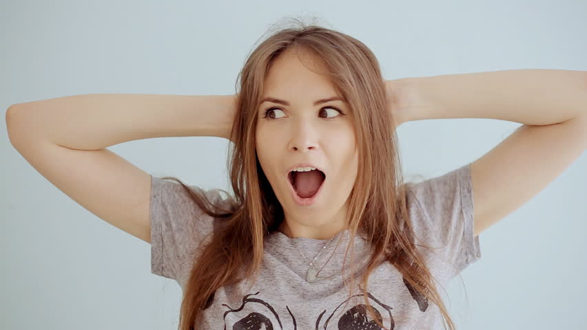 Portrait of young surprised and shocked teen girl