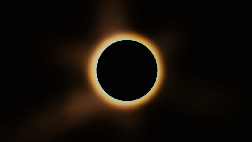 Full solar eclipse. The Moon mostly covers the visible Sun creating a diamond ring effect. This astronomical phenomenon can be seen as a sign of the End of the World.   Shutterstock Video #28907413