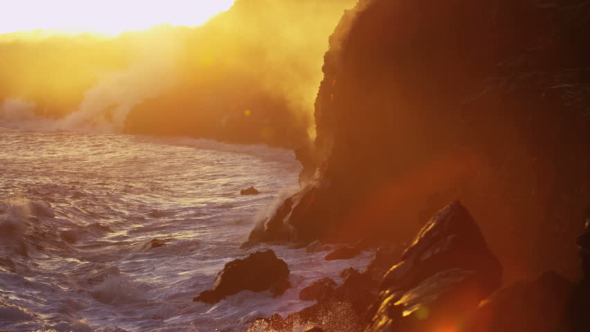 Red hot lava falling into ocean at sunrise causing rising steam seen from distance Hawaii Kilauea Big Island USA RED EPIC | Shutterstock HD Video #29009845