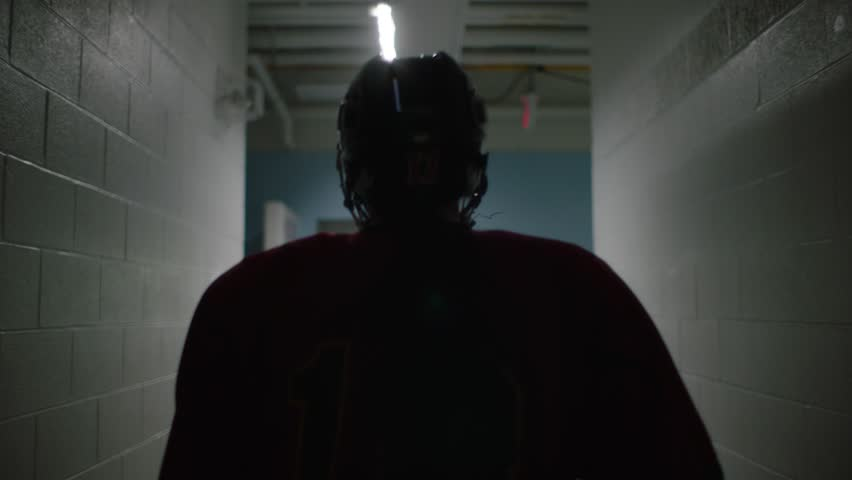 Dramatic footage of hockey player walking towards arena in silhouette. Shot in slow motion.    Shutterstock Video #29029795