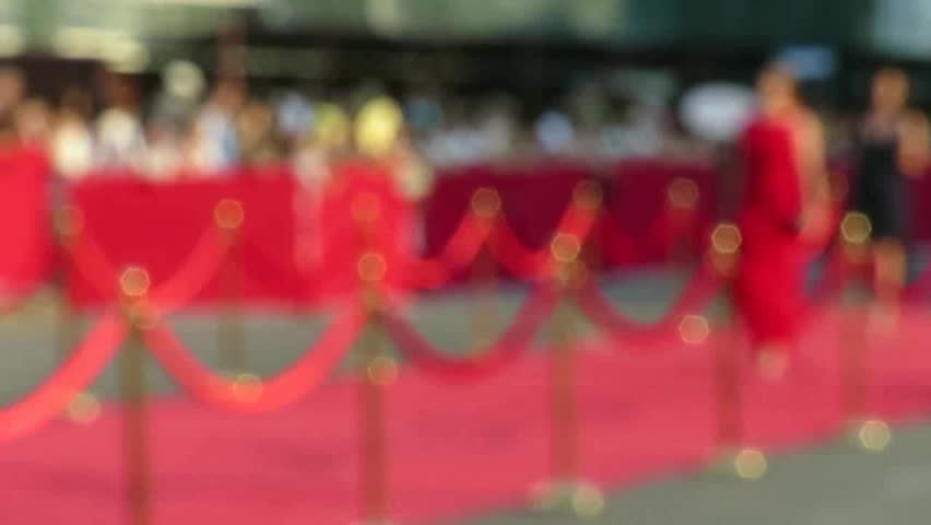 Blurred video. Red carpet entrance with golden stanchions and ropes. Celebrity nominees go to the premiere. Stars on the festive awarding of prizes awards | Shutterstock Video #29211337